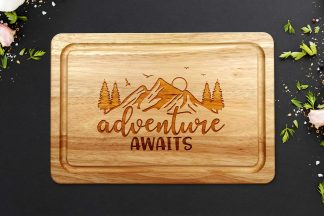 Adventure Awaits Chopping Board on a grey worktop